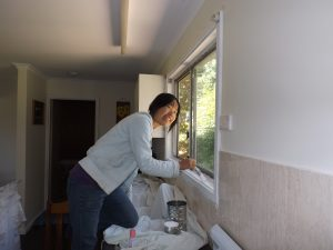 Jenny, our wwoofer painting the kitchen window frame